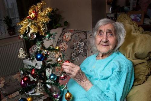 Old Woman Holding Christmas Tree