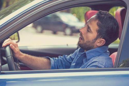 a man falling asleep in a car