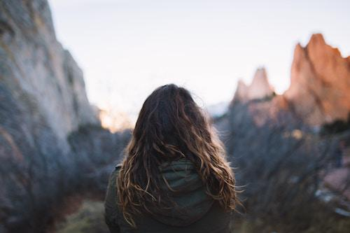girl standing in mountains