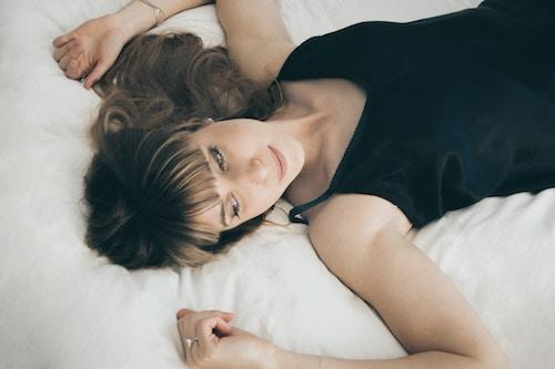 woman lying down feeling emotions paying attention to body