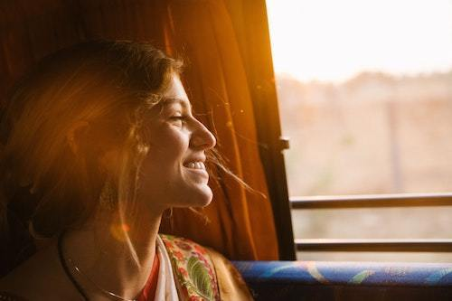 happy woman on the train