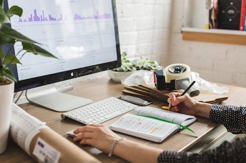 desktop working on statistics motivation