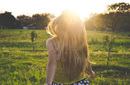 a girl walking in the sun