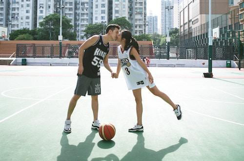 couple playing basketball together