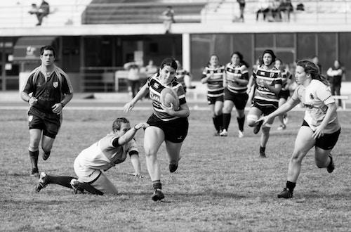 Teens playing rugby
