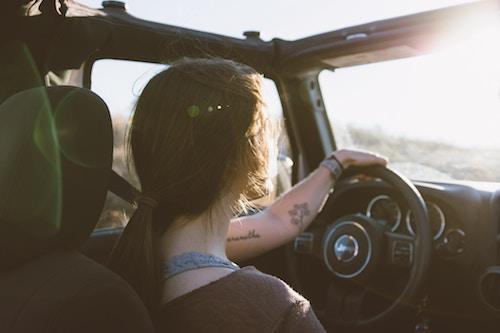 girl driving in car sunset wheel