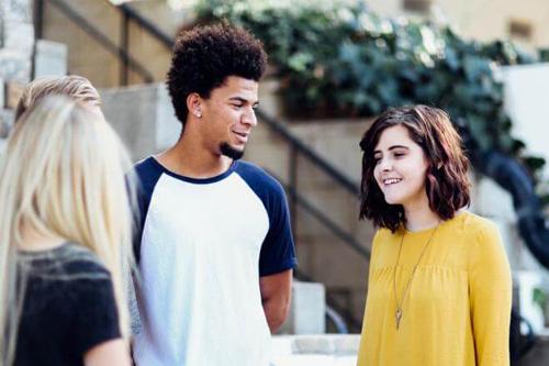 Teenagers having a conversation.
