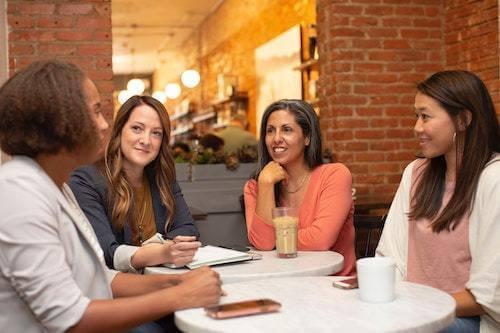 four women having a business meeting