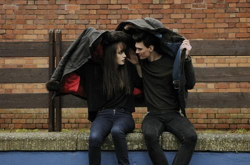 Couple Sharing Jacket