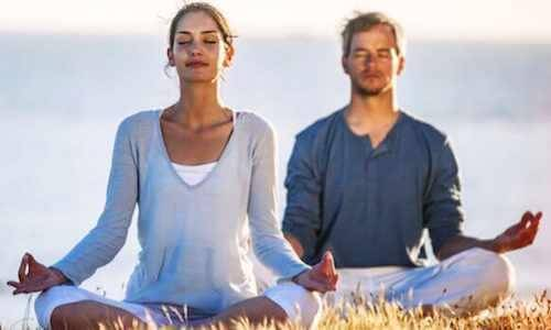 A couple meditating