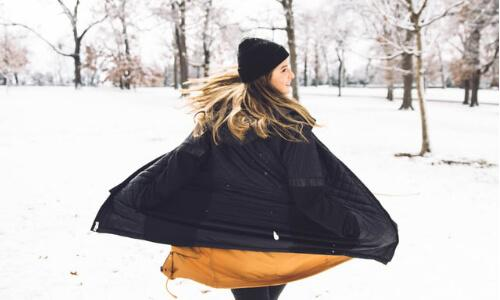 Woman swirling in snow