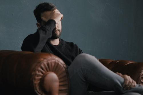 person on a couch depressed