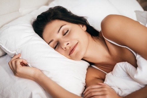 A woman sleeping on a bed