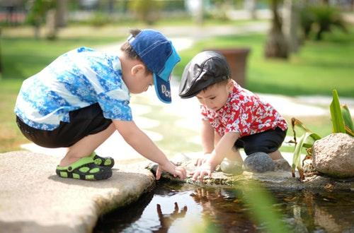 Boys playing near water