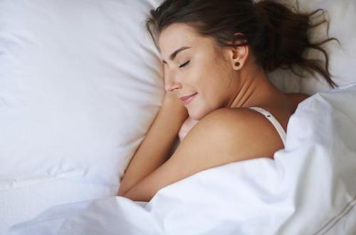 a happy woman sleeping